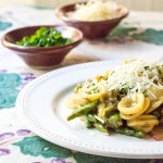 Asparagus carbonara pasta dish with Parmesan cheese, and topped with horseradish breadcrumbs