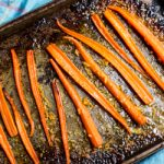 Citrus roasted carrots with chopped ginger.