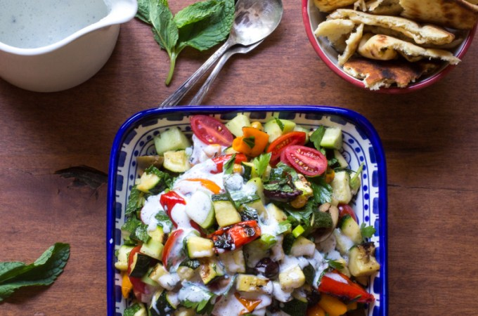 Grilled fattoush salad with grilled peppers and zucchini, tossed with tomatoes, cucumbers, green onions, and chickpeas dressed in buttermilk-yogurt dressing.