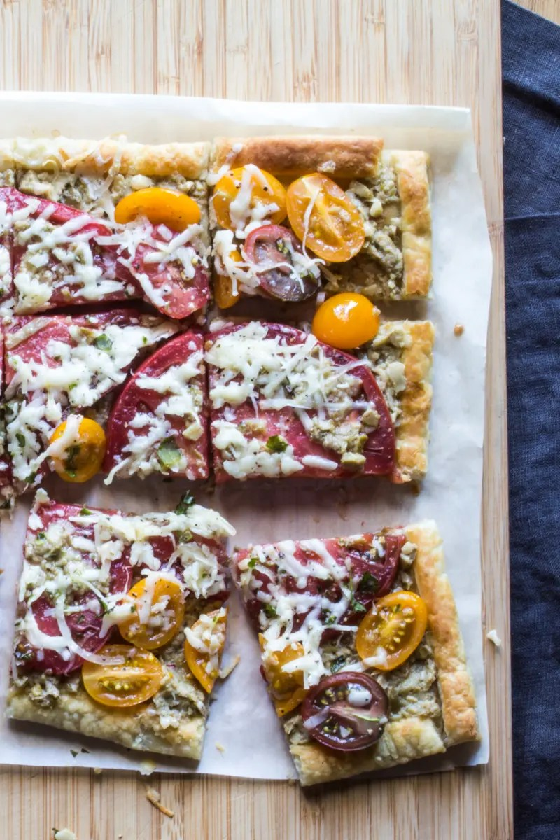 Easy summer tart to celebrate tomatoes, with an artichoke spread and cheese.