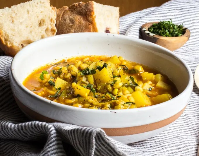 Barley soup with potatoes, mint, lime, and a little turmeric.