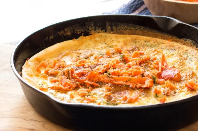 Savory Finnish baked pancakes with dill, topped with smoked salmon. Perfect brunch dish!