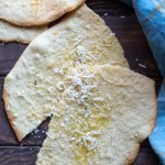 Easy piadina Italian flatbread with Parmesan cheese.