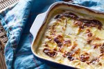 Old-fashioned potato gratin with garlic, rosemary, and Gruyere cheese. Perfect make-ahead dish for a buffet dinner.