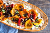 Cajun-spiced peppers and beans over cheesy cauliflower grits.