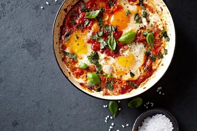Shakshouka Eggs (poached eggs in a spicy tomato sauce)