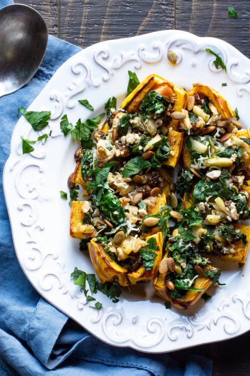 Delicata squash stuffed with sautéed apples, spinach, quinoa, shallots, Serrano chile and tofu.