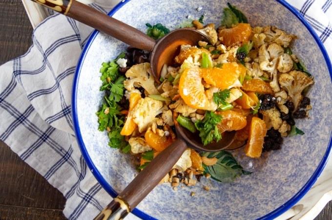 Citrus salad with Sumo citrus, roasted cauliflower, kalamata olives, scallions, raisins, and cashews + citrus vinaigrette. #HealthyRecipe #HealthySalad #Citrus #cauliflower #EasyDinner #DinnerSalad