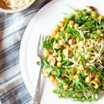 Super-easy super-quick vegan chickpea salad that's ready to eat in 15 minutes. It has green olives, sun-dried tomatoes, arugula and my favorite vegan Parmesan-style cheese on top.