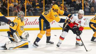 PK Subban of the Nashville Predators defends against Mikael Backlund of the Calgary Flames in front of Pekka Rinne of the Predators.