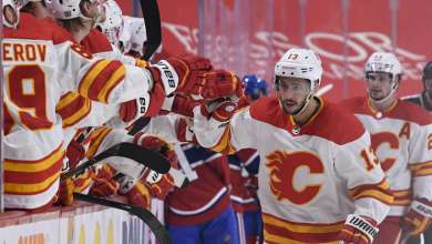 MONTREAL, QC - JANUARY 30: Johnny Gaudreau #13 of the Calgary Flames celebrates with the bench after scoring a goal against the Montreal Canadiens in the NHL game at the Bell Centre on January 30, 2021 in Montreal, Quebec, Canada. (Photo by Francois Lacasse/NHLI via Getty Images)