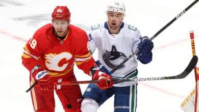 CALGARY, ALBERTA - JANUARY 18: Nikita Nesterov #89 of the Calgary Flames skates against Tanner Pearson #70 of the Vancouver Canucks at Scotiabank Saddledome on January 18, 2021 in Calgary, Alberta. (Photo by Gerry Thomas/NHLI via Getty Images)