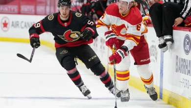 OTTAWA, ON - MARCH 24: Juuso Valimaki #6 of the Calgary Flames stickhandles the puck against Alex Formenton #59 of the Ottawa Senators at Canadian Tire Centre on March 24, 2021 in Ottawa, Ontario, Canada. (Photo by Andre Ringuette/NHLI via Getty Images)