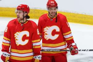 CALGARY, AB - APRIL 26: Johnny Gaudrea #13 and Andrew Mangiapane #88 of the Calgary Flames get fired up in warm-up prior to the game against the Montreal Canadiens at Scotiabank Saddledome on April 26, 2021 in Calgary, Alberta, Canada. (Photo by Jenn Pierce/NHLI via Getty Images)