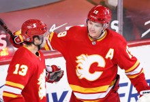 Calgary Flames' Matthew Tkachuk, right, celebrates a goal with teammate Johnny Gaudreau during second period NHL hockey action against the Ottawa Senators, in Calgary, Alta., Sunday, May 9, 2021. THE CANADIAN PRESS/Larry MacDougal