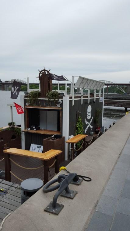 The Burger boat docked in the marina