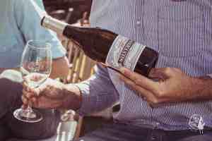 Silvermist Organic Wine Estate Pouring wine Sauvignon Blanc in Constantia Wine Route