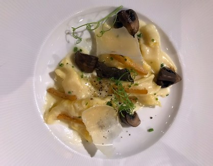 Rolled Pasta with black truffle, root vegetables & roasted parsnip alfredo sauce