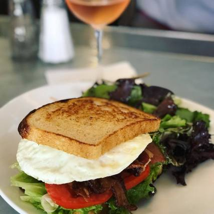 BLT with an egg. Served up with a glass of Rosé from Saintsbury - Boonfly Cafe