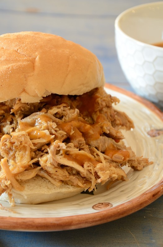 Pulled pork with only 15 minutes effort and 4 ingredients! You can choose the slow cooker or pressure cooker method. Either way is delicious!