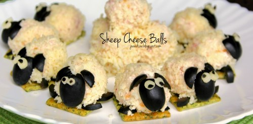 Cheese balls on a cracker with black faces and ears to look like sheep