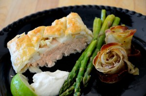 Salmon in Puff pastry plated with lime cream