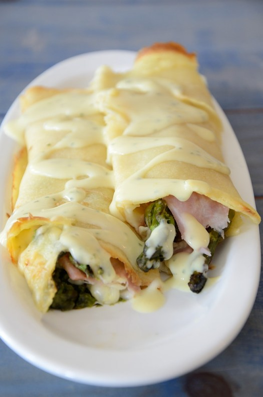 These Ham and Asparagus Crepes make a nice light lunch. If you make the crepes ahead, they come together really quickly using deli ham and cheese slices and fresh asparagus.