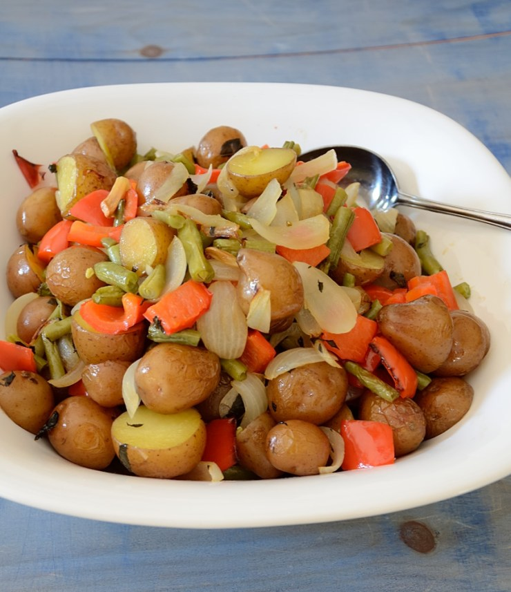This roasted Sheet Pan Potato Salad incorporates so many other vegetables it could serve as all your sides!