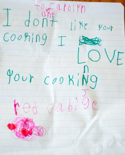 Child hand written note that says Ant Carolyn, I don't like your cooking - I love your cooking, red cabbage drawn below