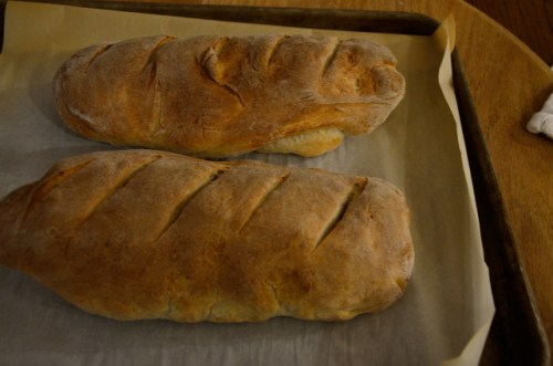 2 golden baked french bread loaves