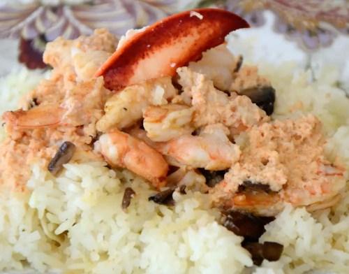 Jumbo shirmp and lobster meat in Irish whiskey cream sauce over white rice
