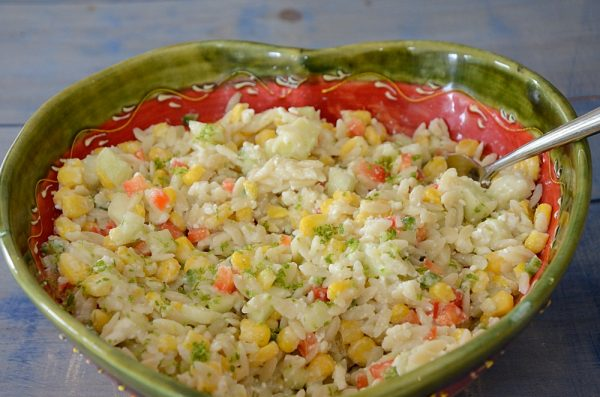 Orzo Corn Salad with Cucumber Feta Dressing in a heart shaped bowl.