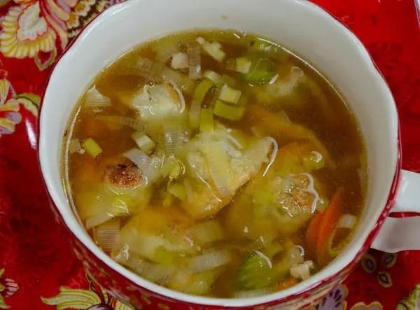 Chicken wonton soup in a bowl