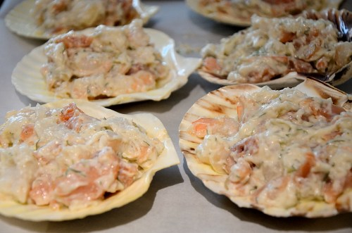 Creamy seafood mixture on scallop shells
