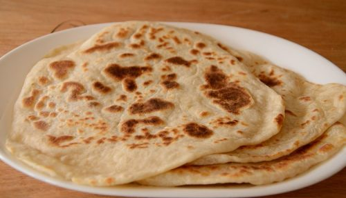 Stack of no yeast flatbreads on a platter