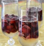 Champagne gelatin with fresh cherries in a champagne flute