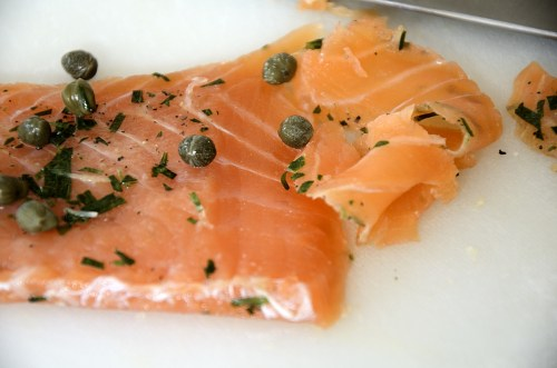 A fillet of cured salmon with capers and tarragon.