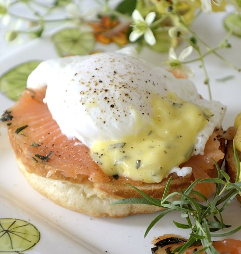 One poached egg on croissant bun with cured salmon and bearnaise sauce.