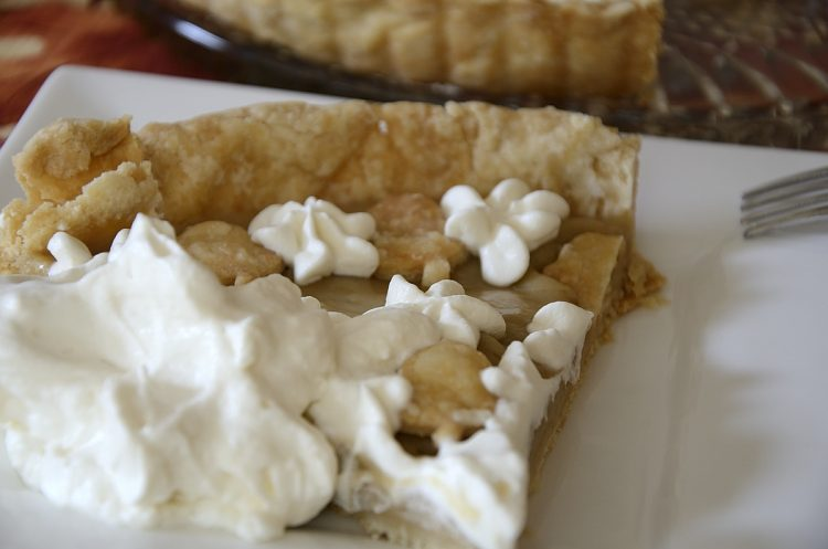 slice of Maple Cream Tarte decorated with whipped cream.