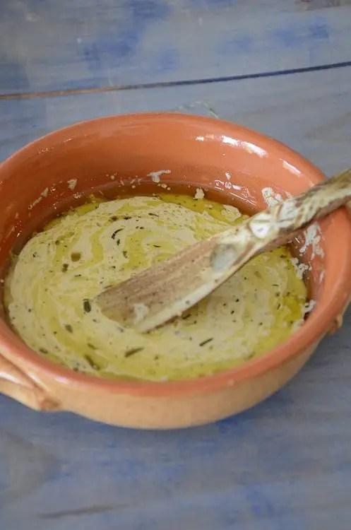 Creamy Cafe de Paris sauce in a serving bowl.