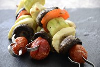 Halloumi cheese, zucchini, mushroom and tomatoes on a skewer.