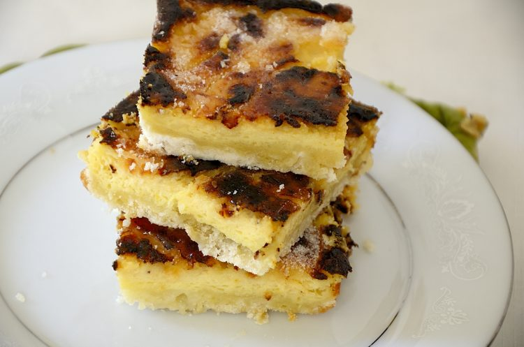 Stack of Creme Brulee squares on plate.