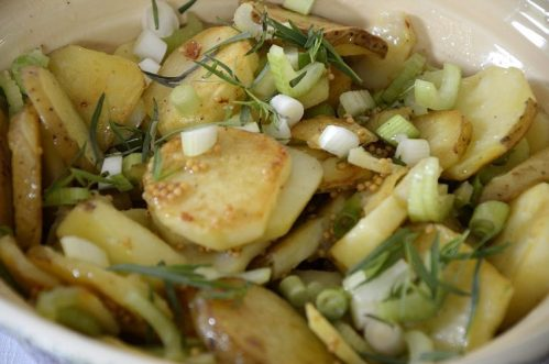 Crispy grilled potato slices tossed with celery, green onions and mustard vinaigrette.