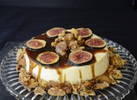 Creamy, cheesecake with balsamic caramel drizzled on top, garnished with fresh fig slices and candied walnuts.