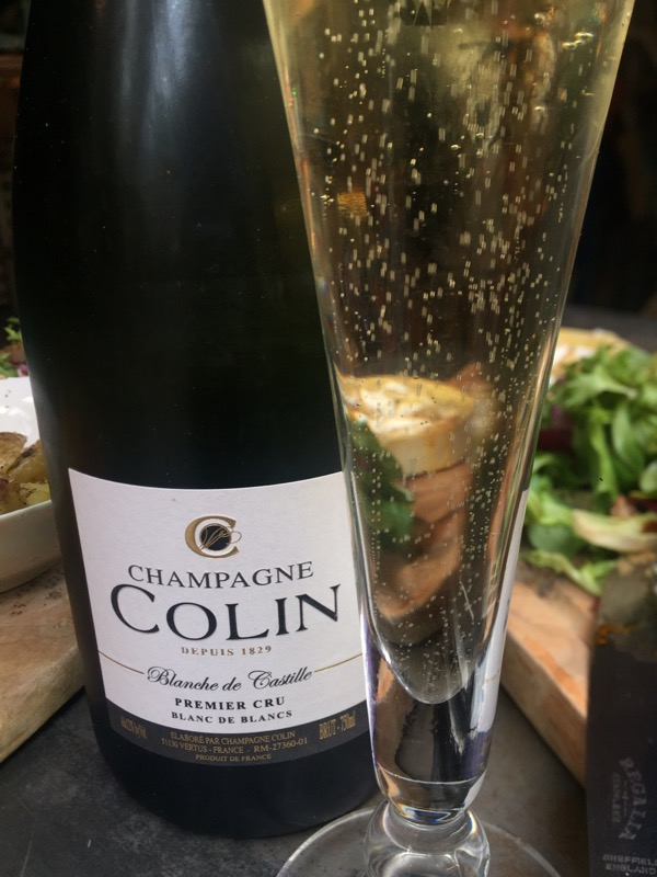 a glass of Colin Premier Cru, Blanc de Blancs Champagne at Champagne + Fromage, Brixton Village, Brixton, London