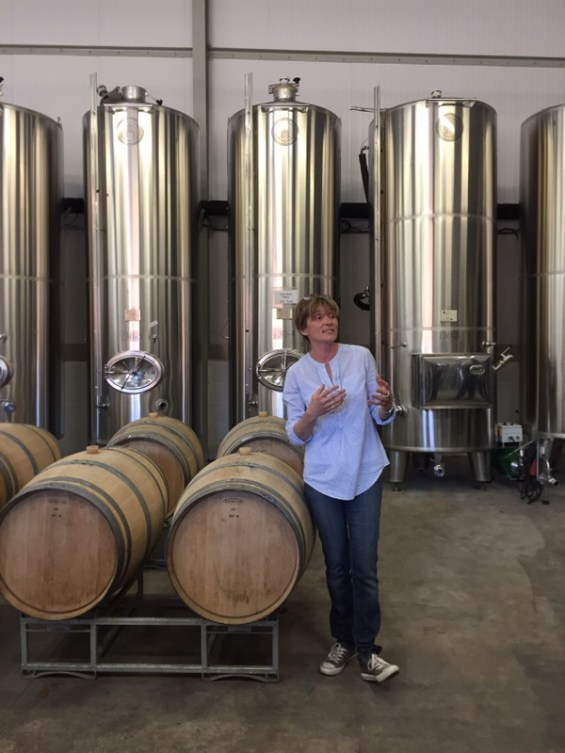 winemaker Alison Nightingale in the winery with oak barrels, Albourne Estate, Sussex, England, English Vineyard