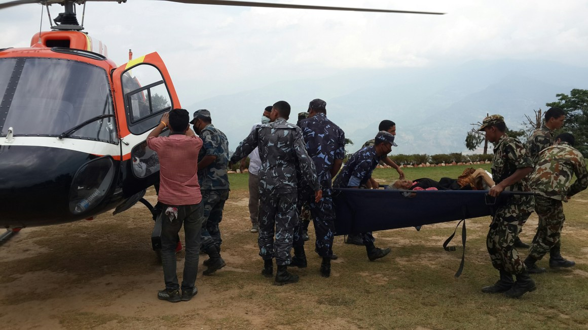 Soldiers carry fly the injured from distant villages in Dolakha to Charikot. [Photo: Aditya Adhikari]