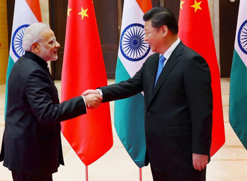 Prime Minister Narendra Modi shakes hands with Chinese President Xi Jinping during a meeting in Xi'an, Shaanxi Province, China. Credit: PTI Photo