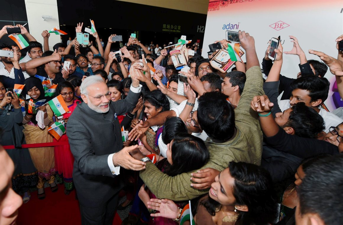 Prime Minister Narendra Modi meeting Indian community people at a reception in Shanghai on Saturday. Credit: PTI Photo