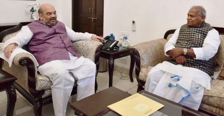 Former Bihar chief minister and chief of Hindustani Awam Morcha (HAM) Jitan Ram Manjhi meeting Bharatiya Janata Party President, Amit Shah in New Delhi on Thursday.  PTI Photo by Vijay Verma